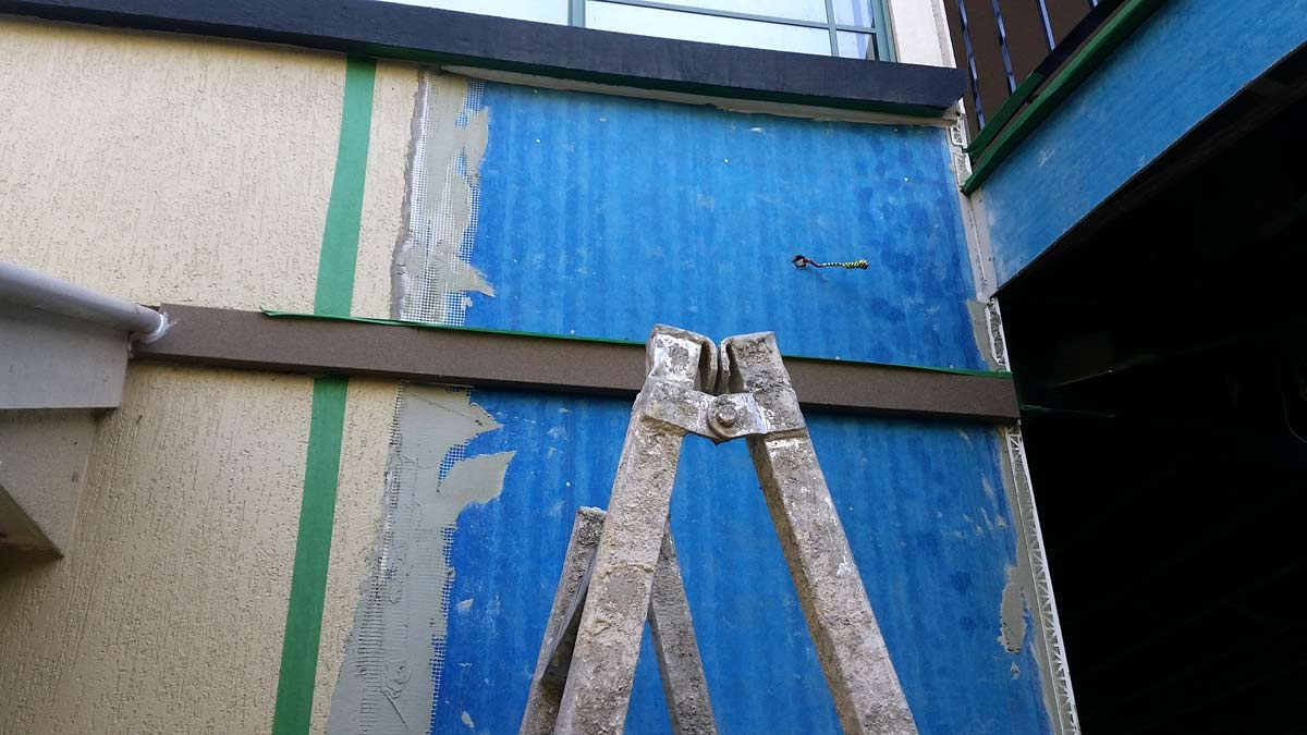 House damaged in storm with prepared blue walls