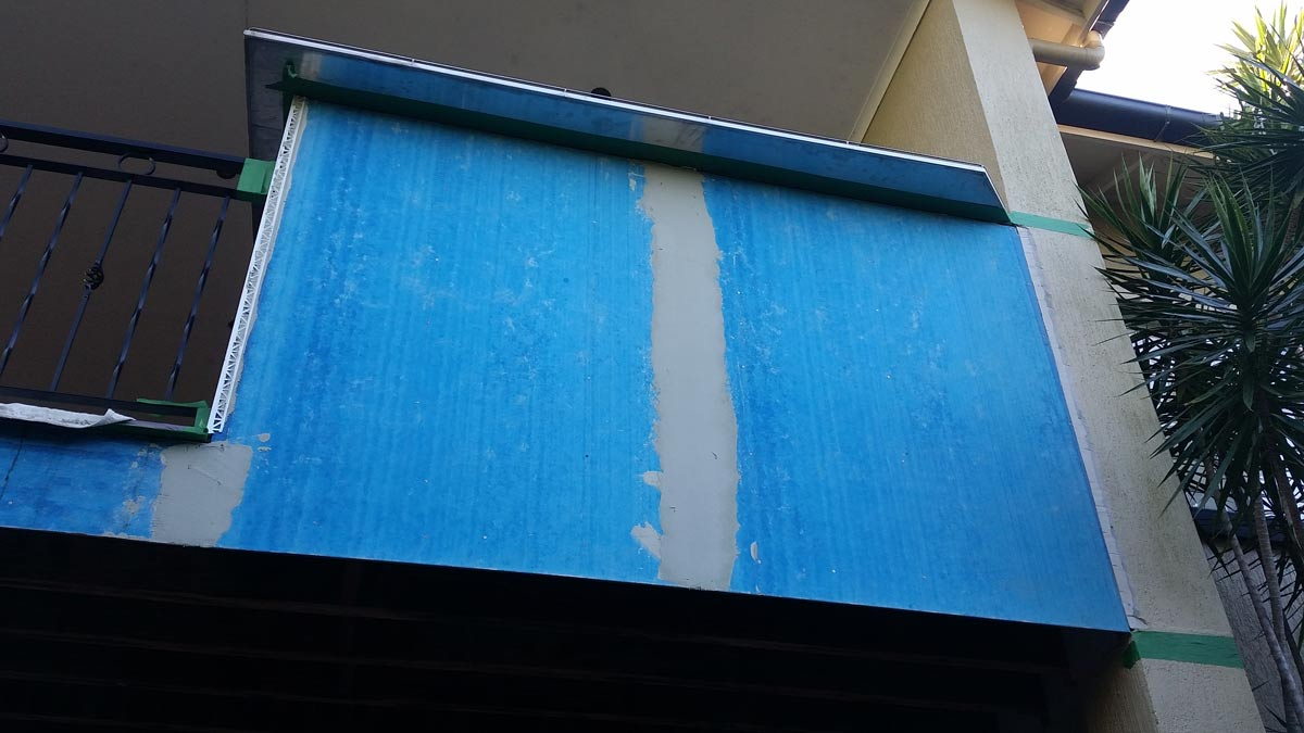 blue boards on balcony facia